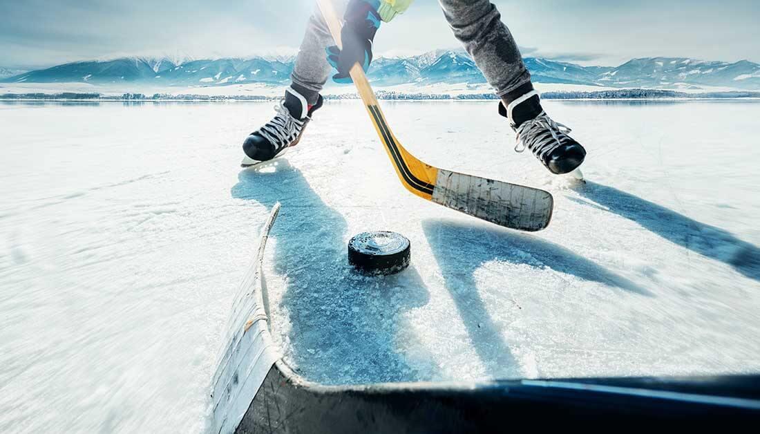 Hockey player on lake ice