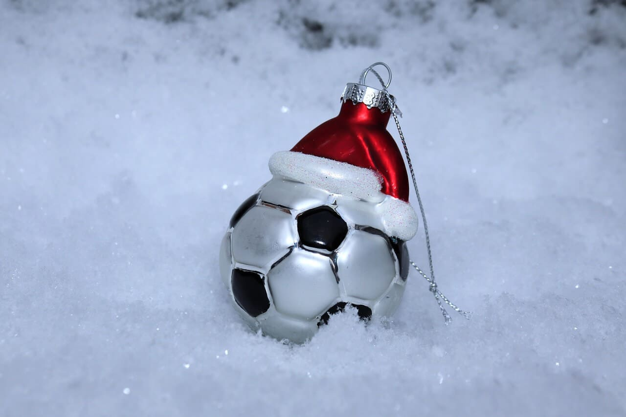 Betting on football on Boxing day - snow football ball
